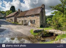 beautiful thatched cottages beside a ford at ponsworthy on