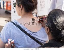 tattoo artist applying stock photos u0026 tattoo artist applying stock
