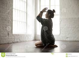 young attractive woman in vajrasana pose white loft studio back