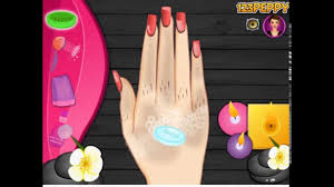 game manicure at the nail salon wax paint cut cuticles