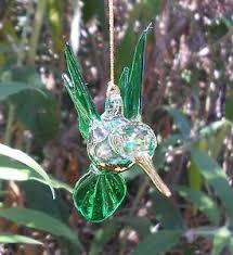 green blown glass hummingbird ornament with gold accents