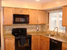 Glass Backsplashes For Kitchens What Color Countertops Go With Dark Cabinets Glass Tile Backsplash