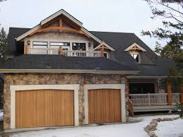 exterior design nice roofing by certainteed landmark shingles for luxury exterior design with certainteed landmark shingles plus wooden garage doors and natural stone wall