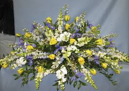 casket spray blue and yellow casket spray in northport ny fashions in flowers