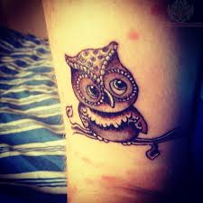 owl sitting on tree brown ink tattoo