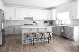 white kitchen cabinets with vinyl plank flooring my friends gorgeous gray and white kitchen cuckoo4design