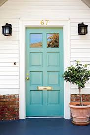 love the light teal color of this bright and happy front door