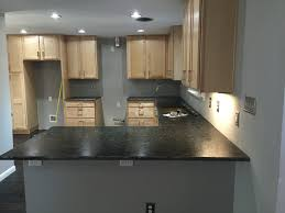 Granite Kitchen Makeovers - countertops installed uba tuba granite with a leather finish