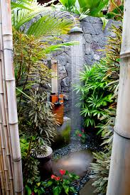 home with plants patio tropical with river rock outdoor shower