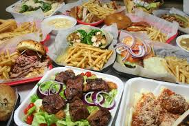table full of food taking orders from consumer behavior how restaurants grocers can