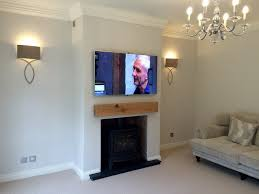 smart tv wall mounted television over a log burner because of the intense heat from