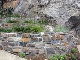3 stone retaining wall ideas for hillside gardens
