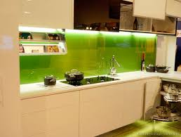 green glass backsplashes for kitchens kitchen of the day modern white cabinets with a solid