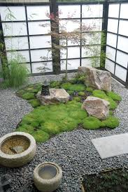 rock garden landscape asian with moss ceramic statues and yard art