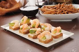 canap toast a serving tray of shrimp canapes on mini wheat toasts with avocado