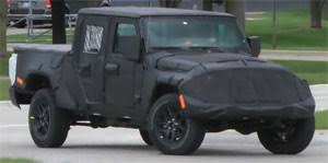 jeep truck spy photos eye spy jeep wrangler pickup motorweek