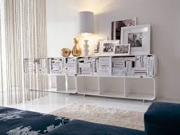 Curved White Sofa by Photograph Curved Vase Blue Sofa Screen White Chains Bookshelves