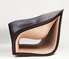 split sofa and chairs by alex hull have beautiful smooth curves