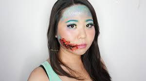 easy halloween inspired look mermaid with bloody torn lips