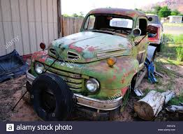 Ford Vintage Truck - an old ford truck sits in a junkyard in america awaiting it u0027s fate