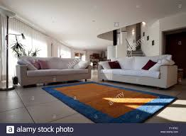 livingroom carpet wide open space livingroom carpet and sofa stock photo royalty