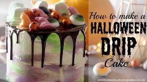 How To Make Halloween Cake by How To Make A Halloween Drip Cake Youtube