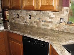 contemporary kitchen backsplash with granite countertops black