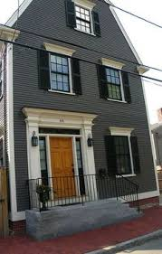 colonial red house with black window trim glass onion lights