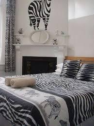 animal print bedroom ideas zebra bedding and wall decor over