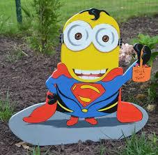 halloween minion in a superman costume lawn art yard stake