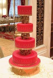 red wedding cake with gold gilded dots wedding cake custom cake