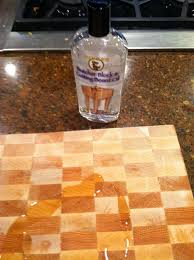 lipstick and sawdust checkerboard butcher block tutorial i purchased this butcher block cutting board oil at hd it is food safe blah blah blah so it won t kill you i poured it on the block