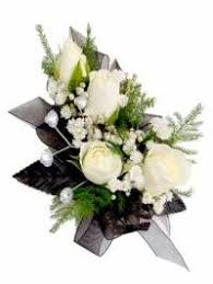 black and white corsage flower wrist corsages and stunning boutonnieres are each custom made