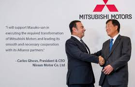 finalizes deal with mitsubishi carlos ghosn to be chairman