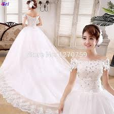 online shop selling white lace trailing wedding dresses