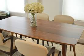 mid century style dining table made entirely of solid wood walnut