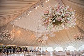 draped ceiling traditional ceremony glamorous garden inspired tented reception