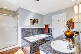 modern bathroom interior with black granite tile trim and white