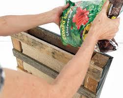how to build a pallet vertical garden and a diy plastic wall garden
