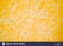 yellow wall paint texture home interior background stock photo