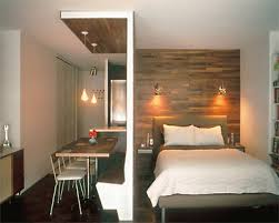 Small Space Designs Brilliant Wood Wall Used To Divide The Space - Small studio apartment designs
