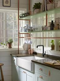 Light Blue Cabinets Light Blue Farmhouse Kitchen Cabinets With Copper Piping Shelves
