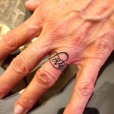 name tattoo on wedding ring finger wedding rings