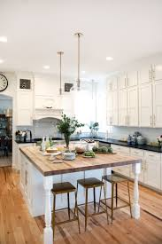 wood countertops white kitchen black island backsplash pattern