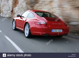 porsche carrera 2005 car porsche carrera 4s model year 2005 red driving diagonal