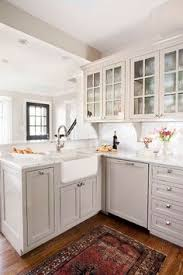kitchens that maximize small footprints glass front cabinets