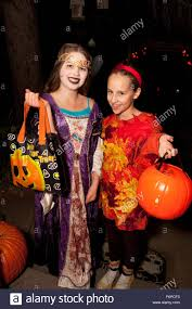 two teen girls trick or treating in halloween costumes st paul