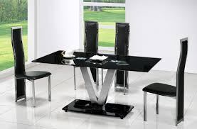 modern open dining room design with futuristic black glass top