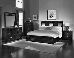 room with black walls grey bedroom wall combined by black wooden bed with white bedding