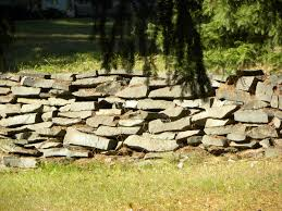 Stone For Garden Walls by Retaining Walls Turn A Retaining Wall Into A Rock Garden